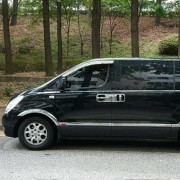 airport-transfer-starex-van-side