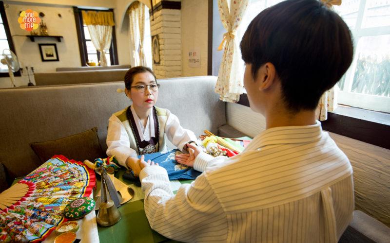 Korean fortune teller holding palm