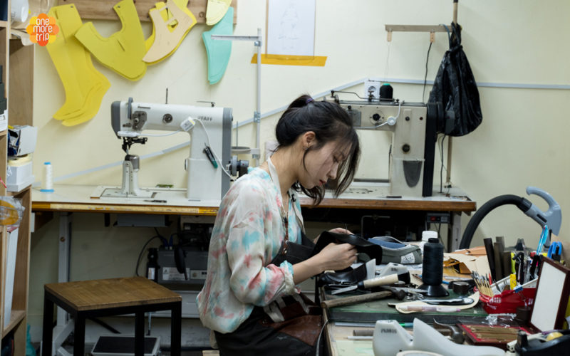 asian girl making shoes