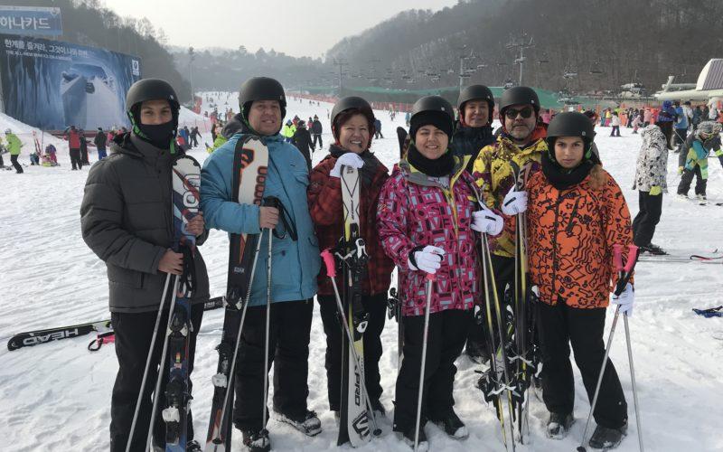 alpensia group skiing pose