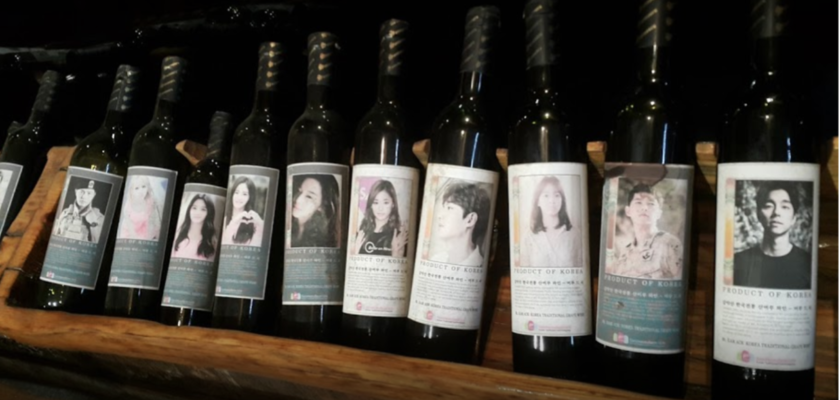 wine bottle with printed face